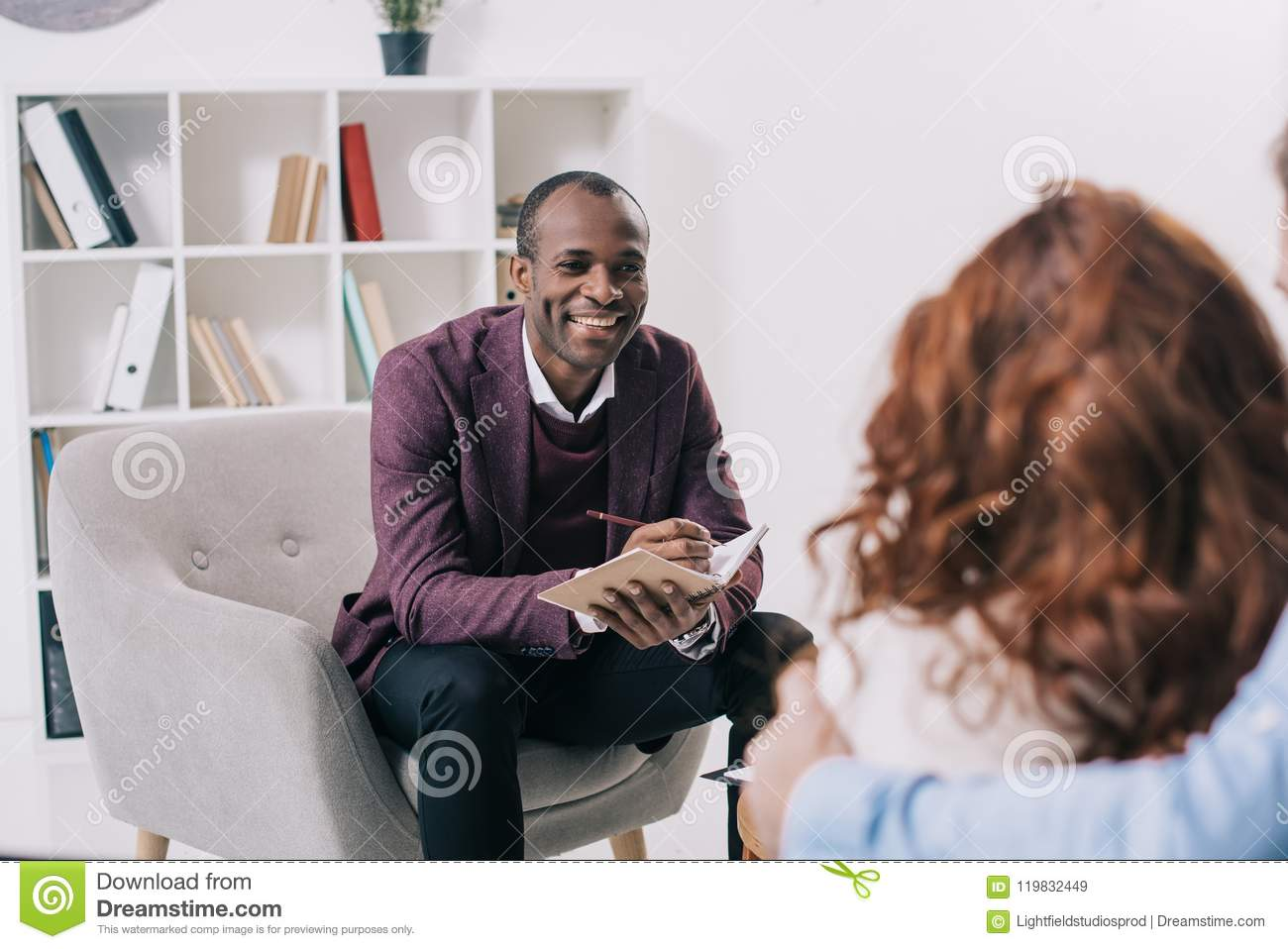 Smiling african american psychiatrist talking to