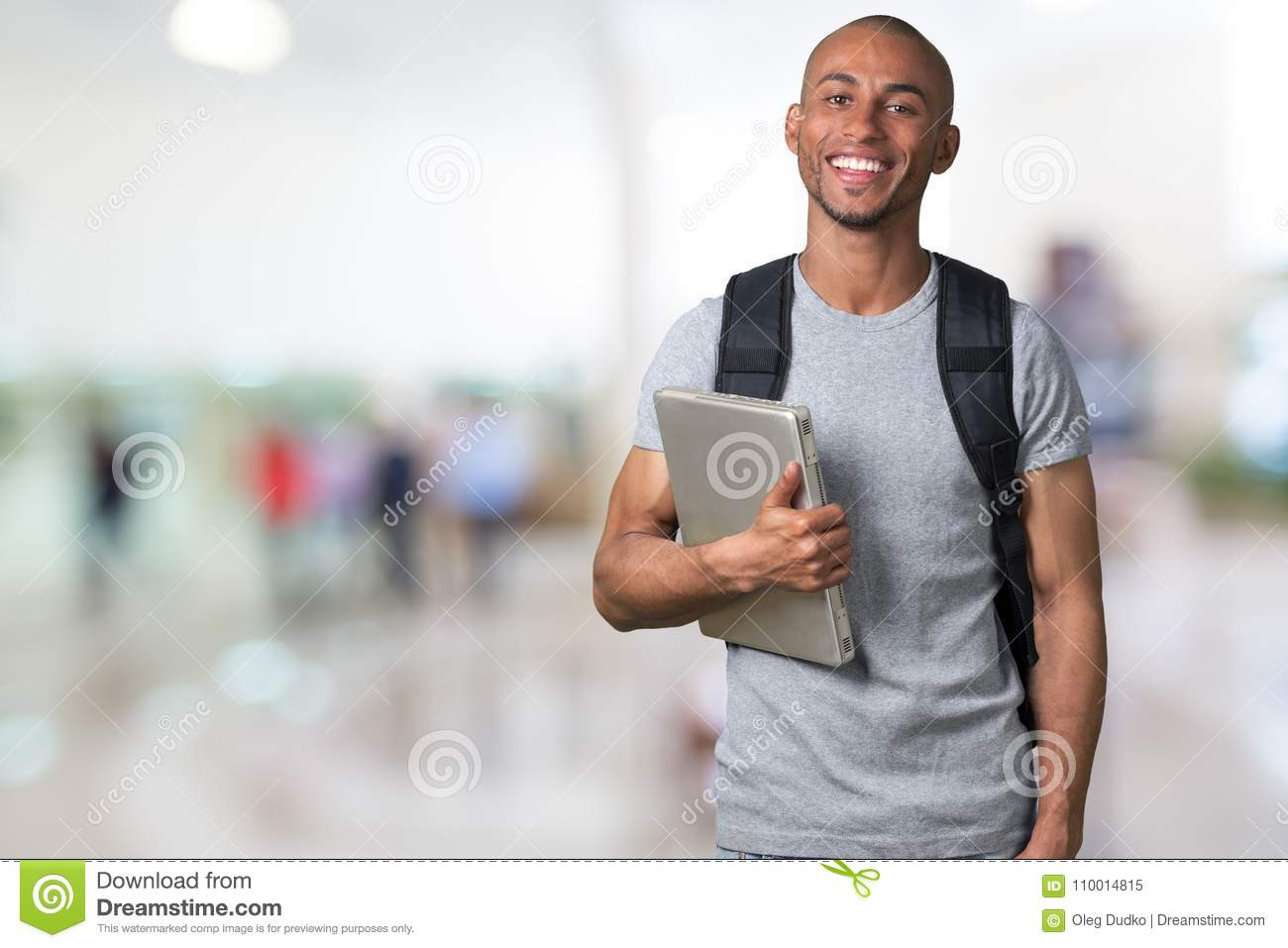 Smiling African Student man with laptop, mall