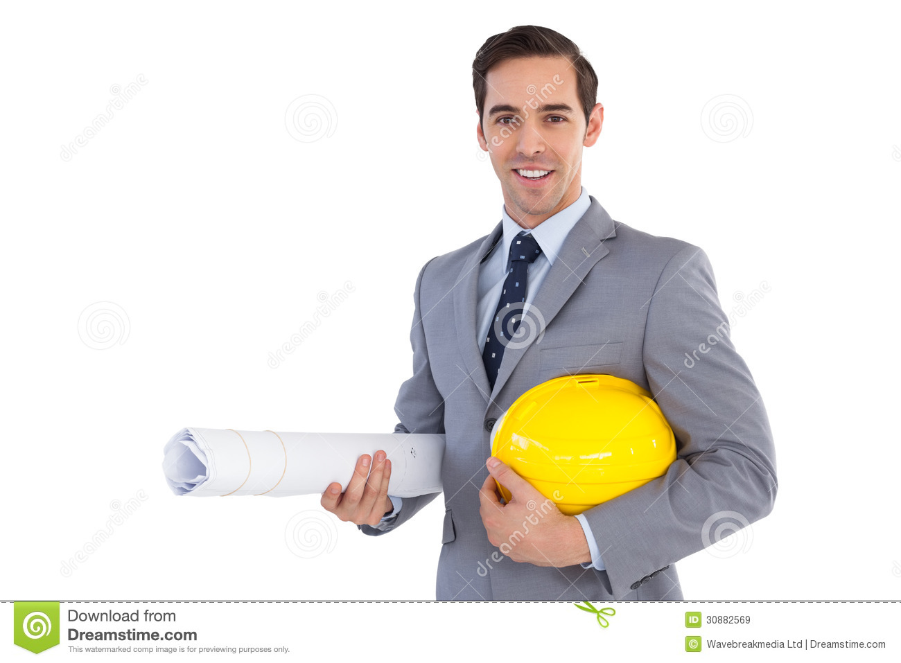 Smiling Architect Holding Plans And Hard Hat Royalty Free