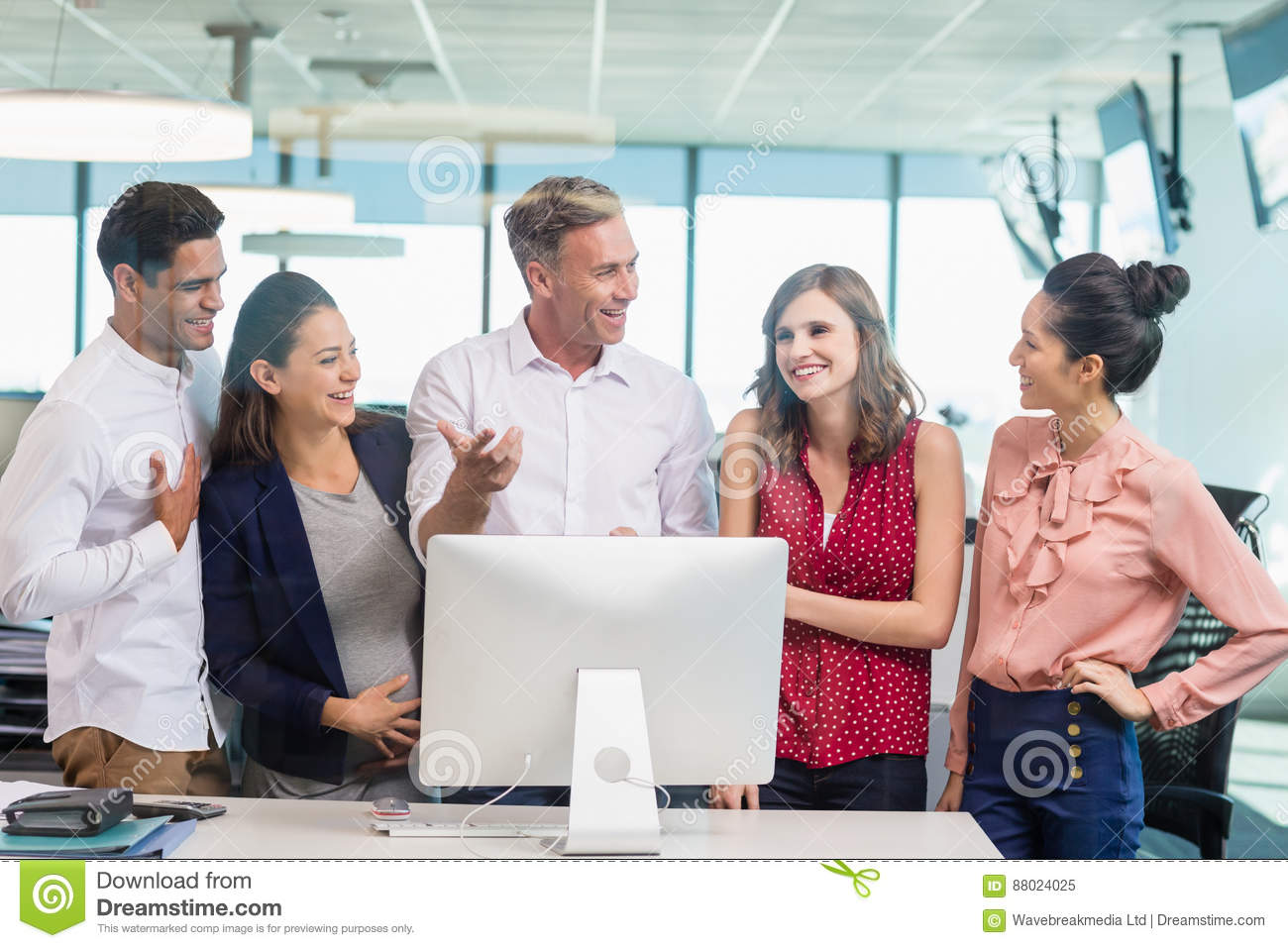 Smiling architects discussing with each other