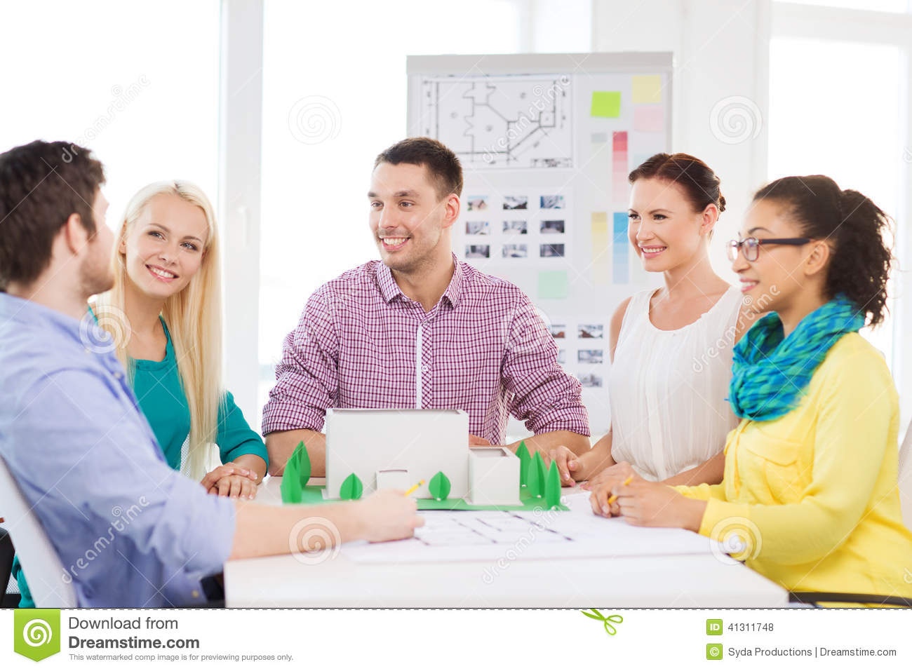 Smiling architects working in office