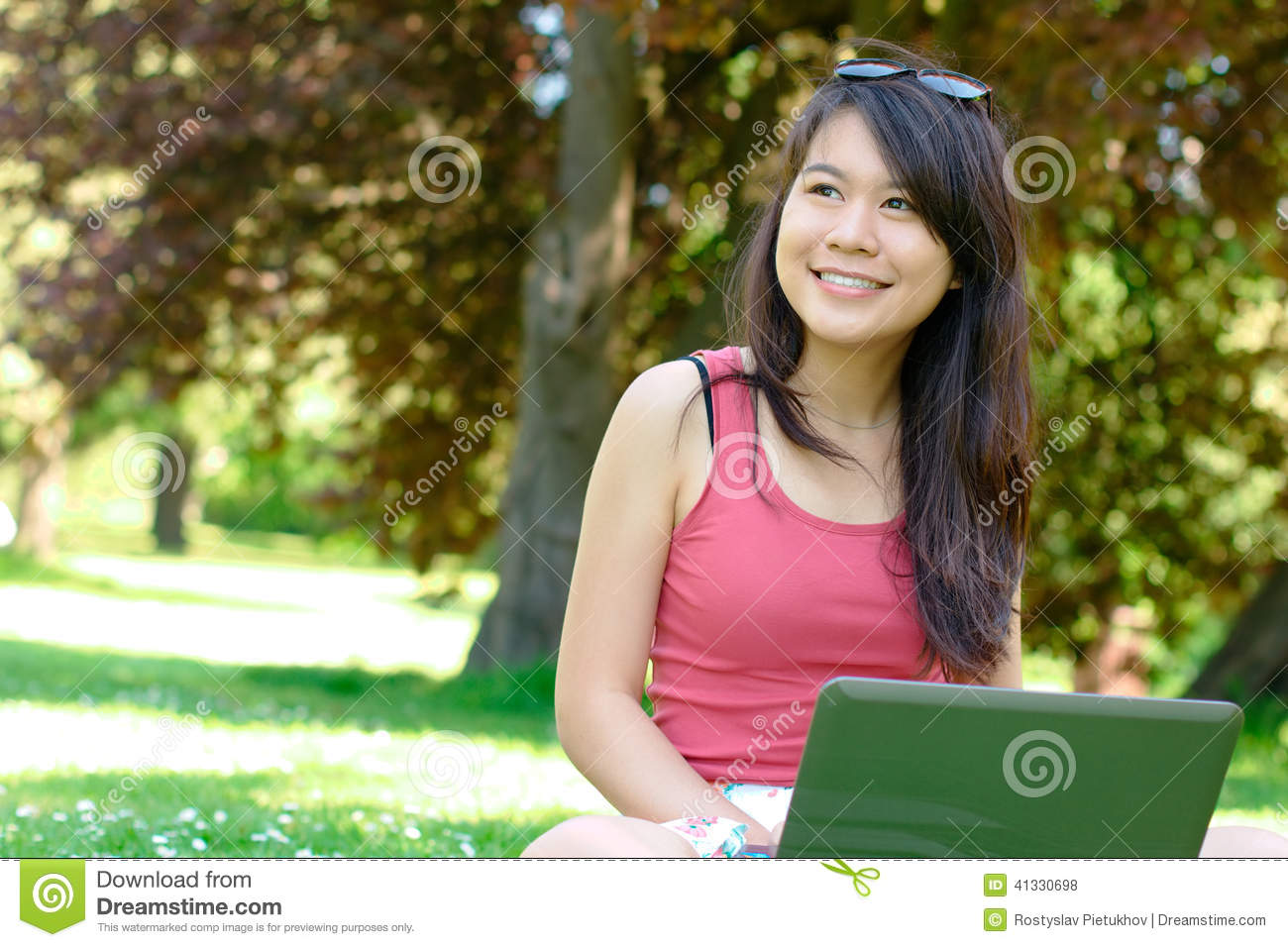 Smiling asian girl at the park