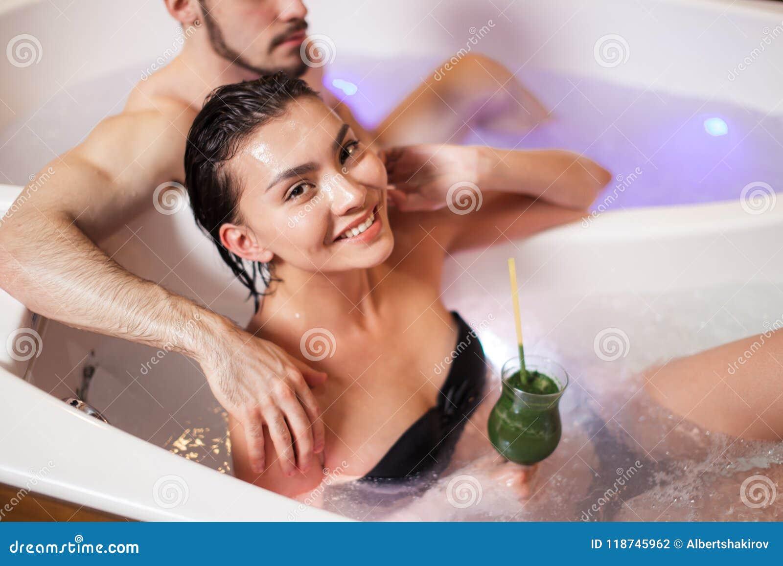 Smiling Asian Lady Enjoying Having Tube With Loving Guy
