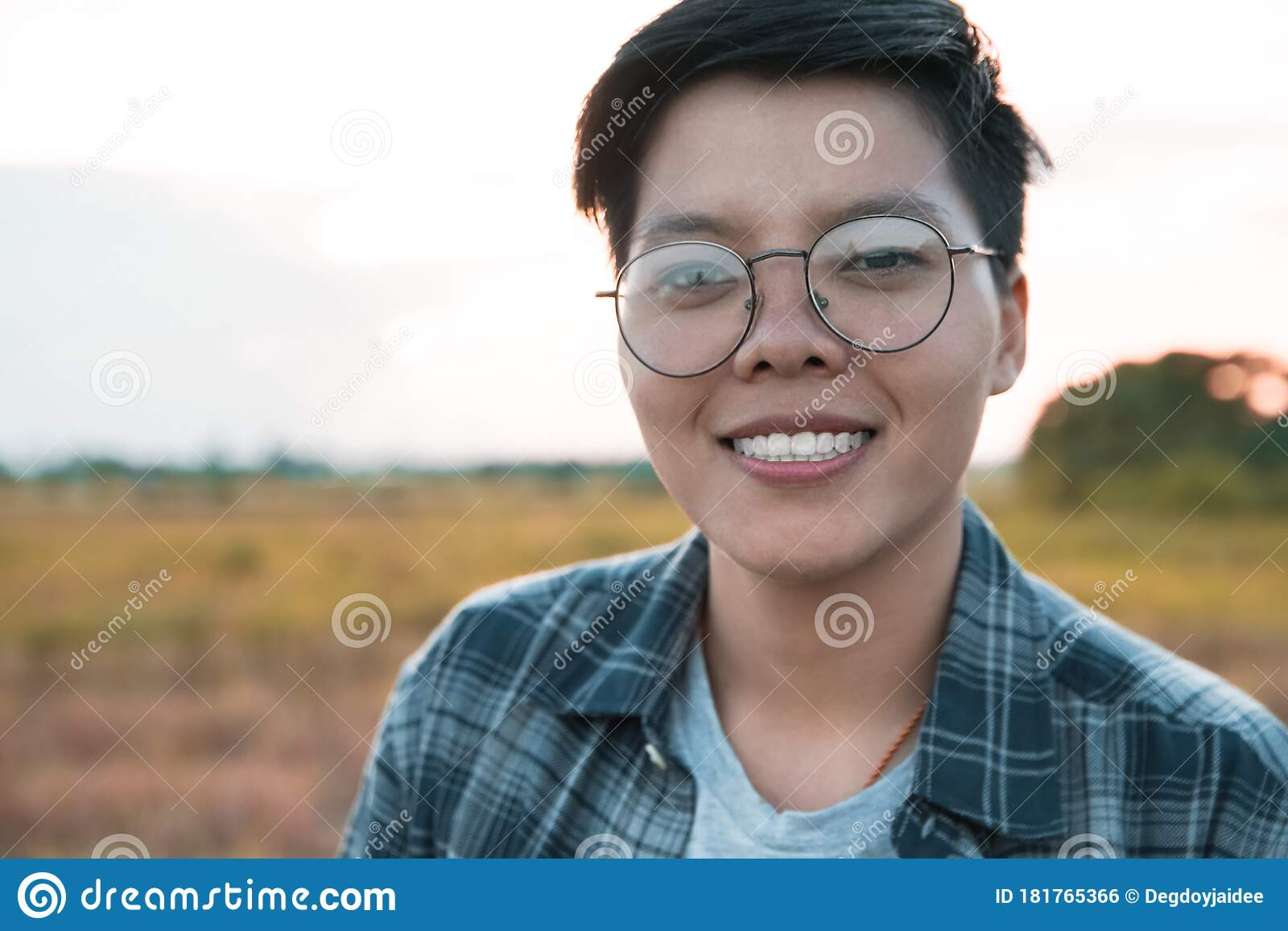Smiling Asian Women Are Short Hair In Eyeglasses Standing On The Field Only One Portrait Lesbian Stock Photo Image Of Hairstyle Eyes 181765366