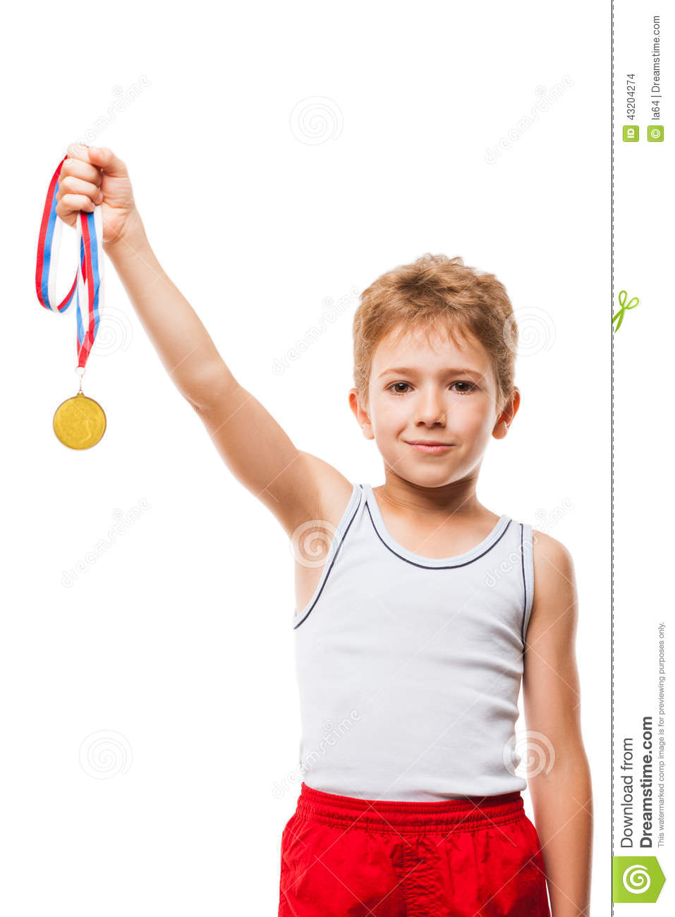 Smiling athlete champion child boy gesturing for victory triumph stock