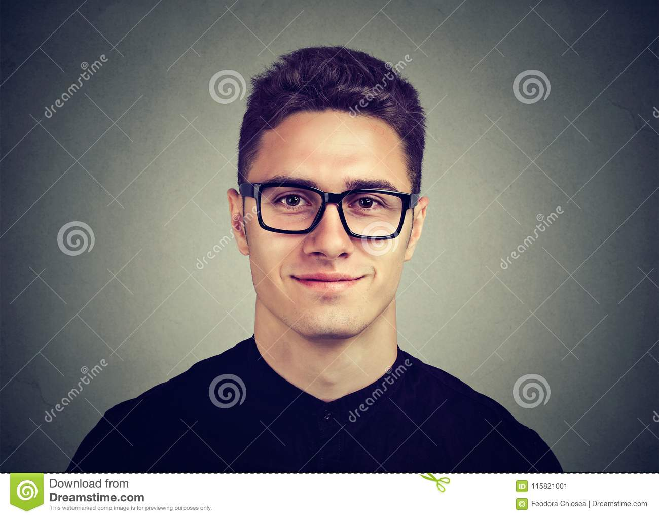 16e0a25e6 Smiling Attractive Man In Glasses With A Modern Hairstyle Stock ...