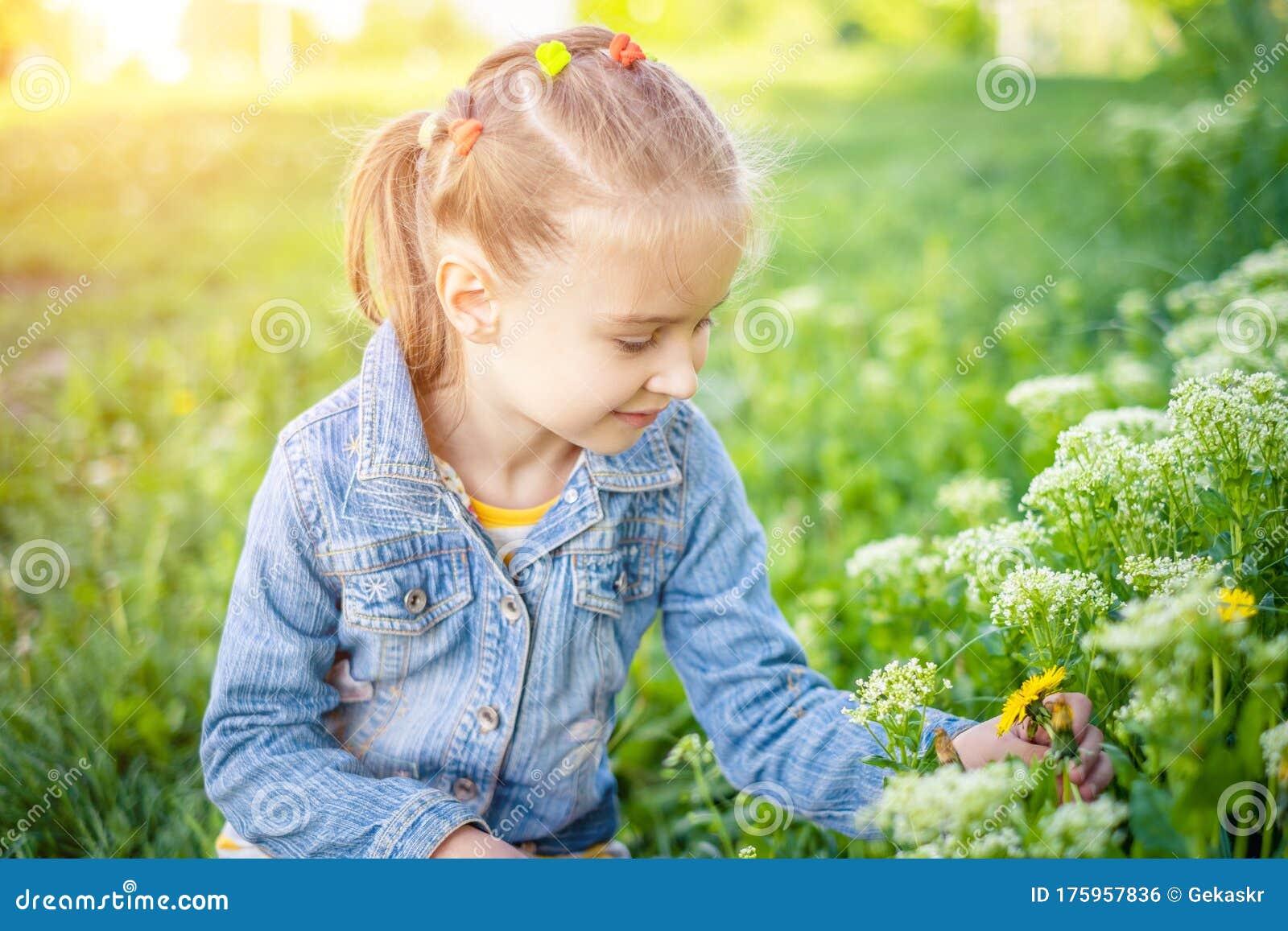 Smiling Little Girl Over Green Grass Background Stock