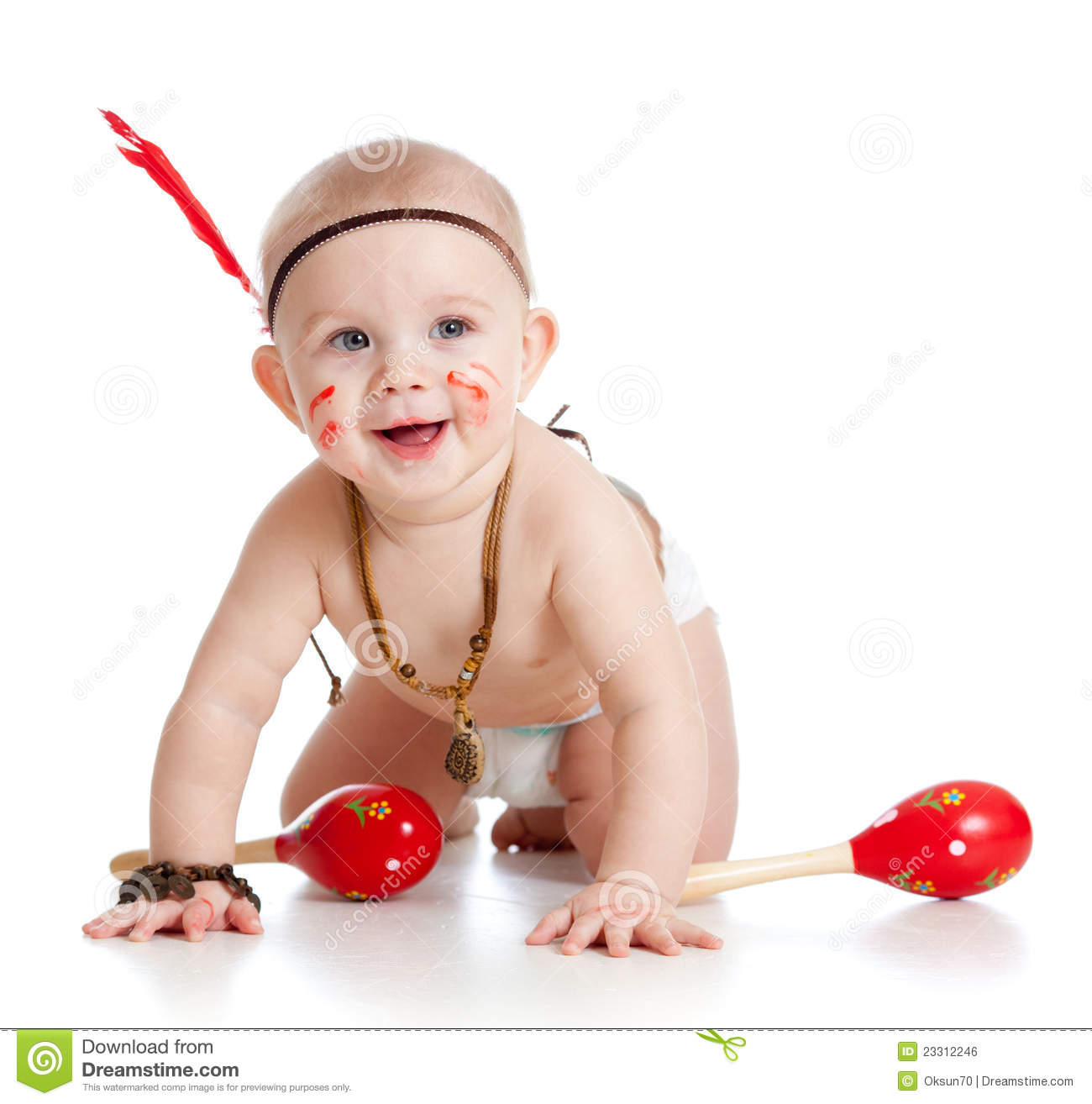 smiling baby as indian boy with musical toy stock photo