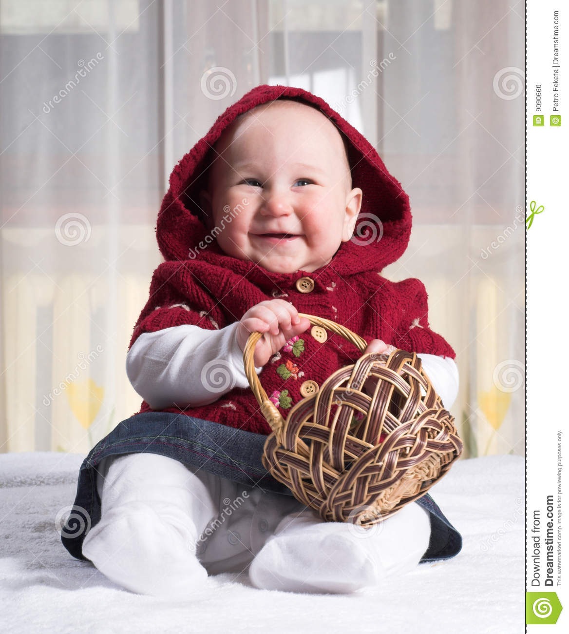 Smiling baby with basket
