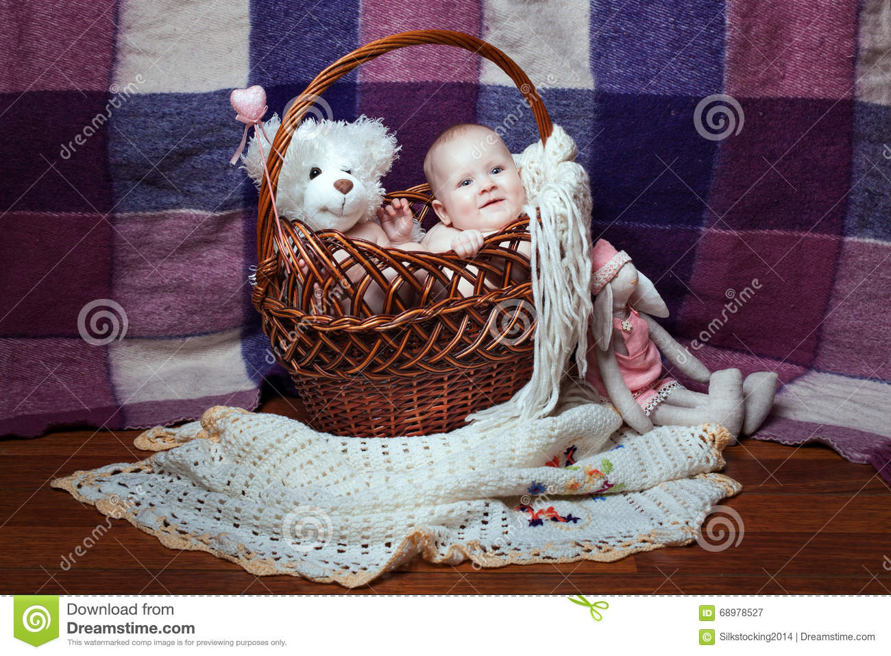 Smiling baby in a basket