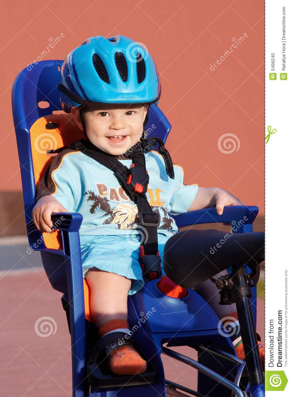 Smiling baby in bicycle seat