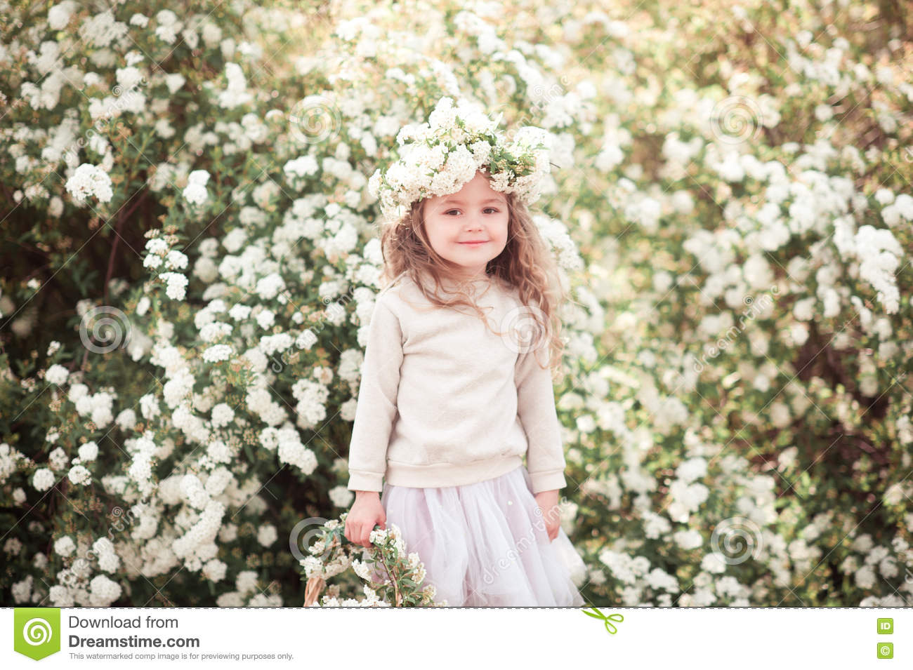 smiling baby girl with flowers in garden stock photo - image of
