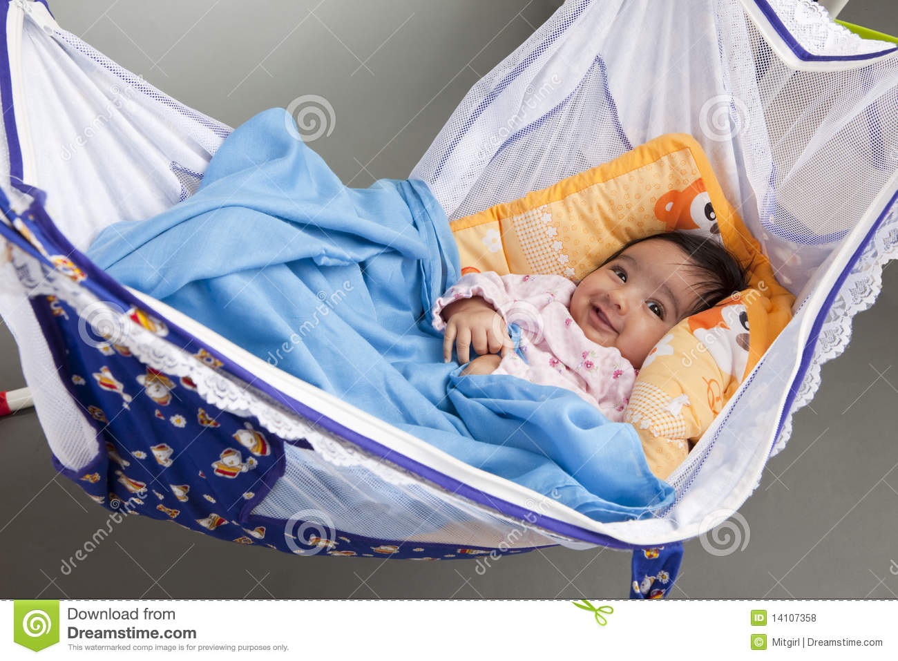 Smiling Baby In A Hammock Style Cradle Stock Photo Image