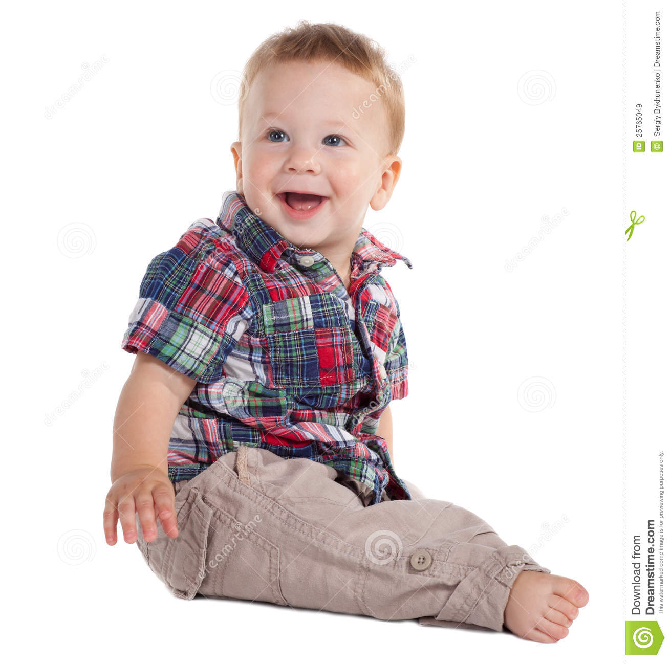 Smiling baby sitting on the floor on white