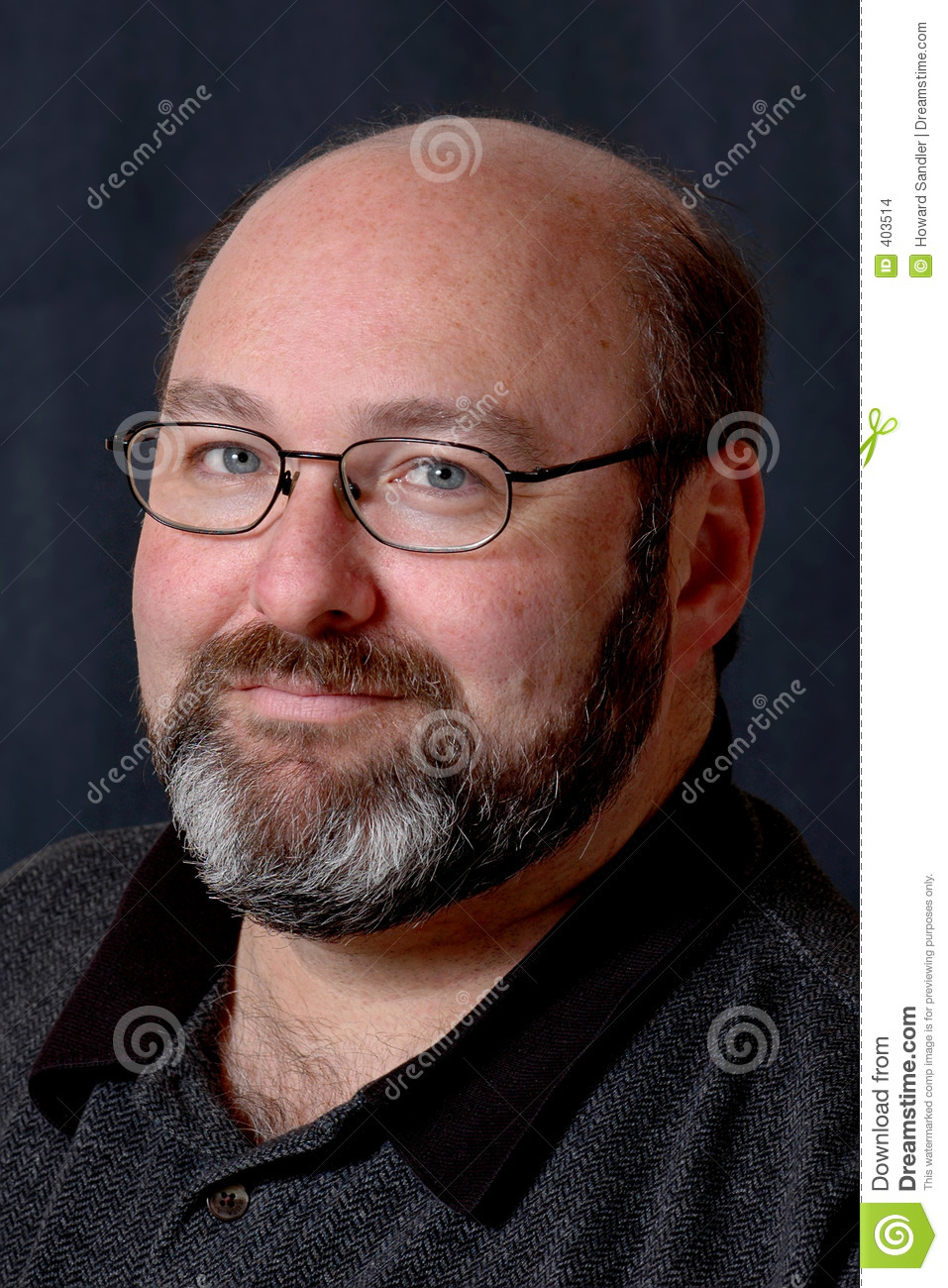 Bald bearded middle aged man with glasses; headshot on dark background ...