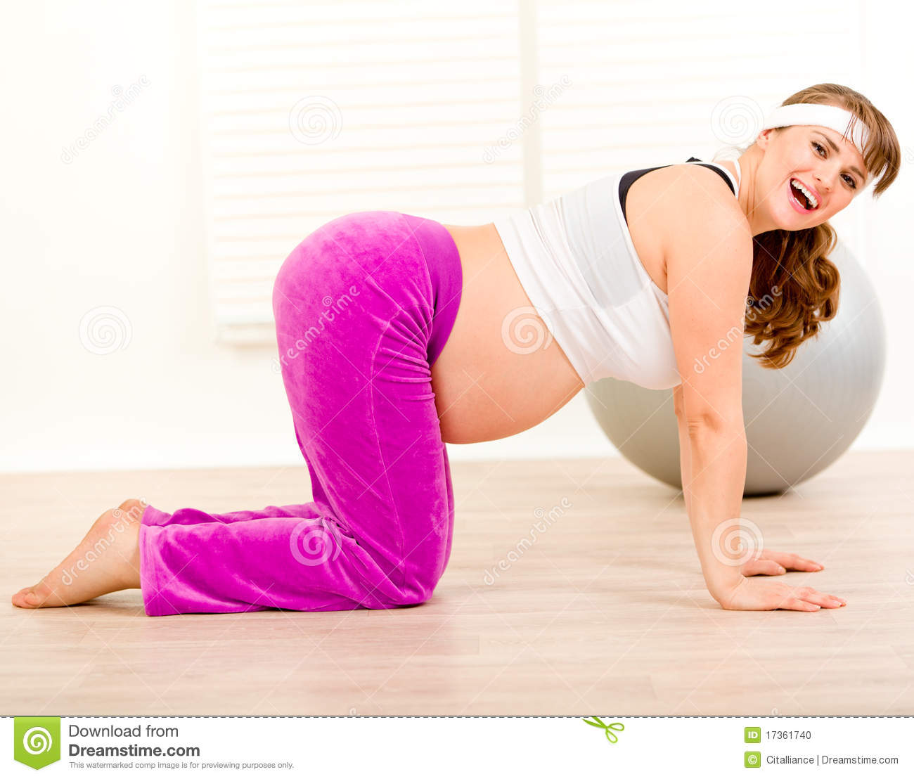 Smiling Beautiful Pregnant Woman Making Gymnastics Stock ...