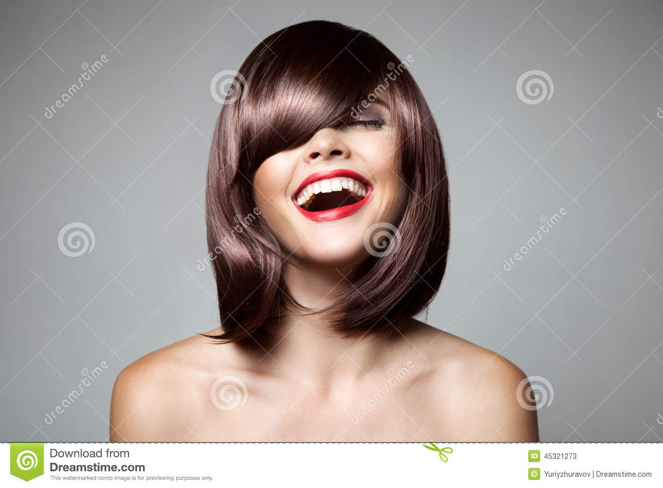 Smiling Beautiful Woman With Brown Short Hair.