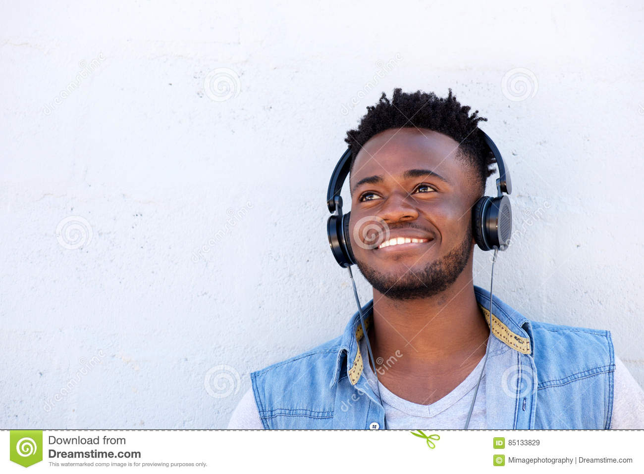 Smiling Man With Headphones Listening To Music Stock Photo ...