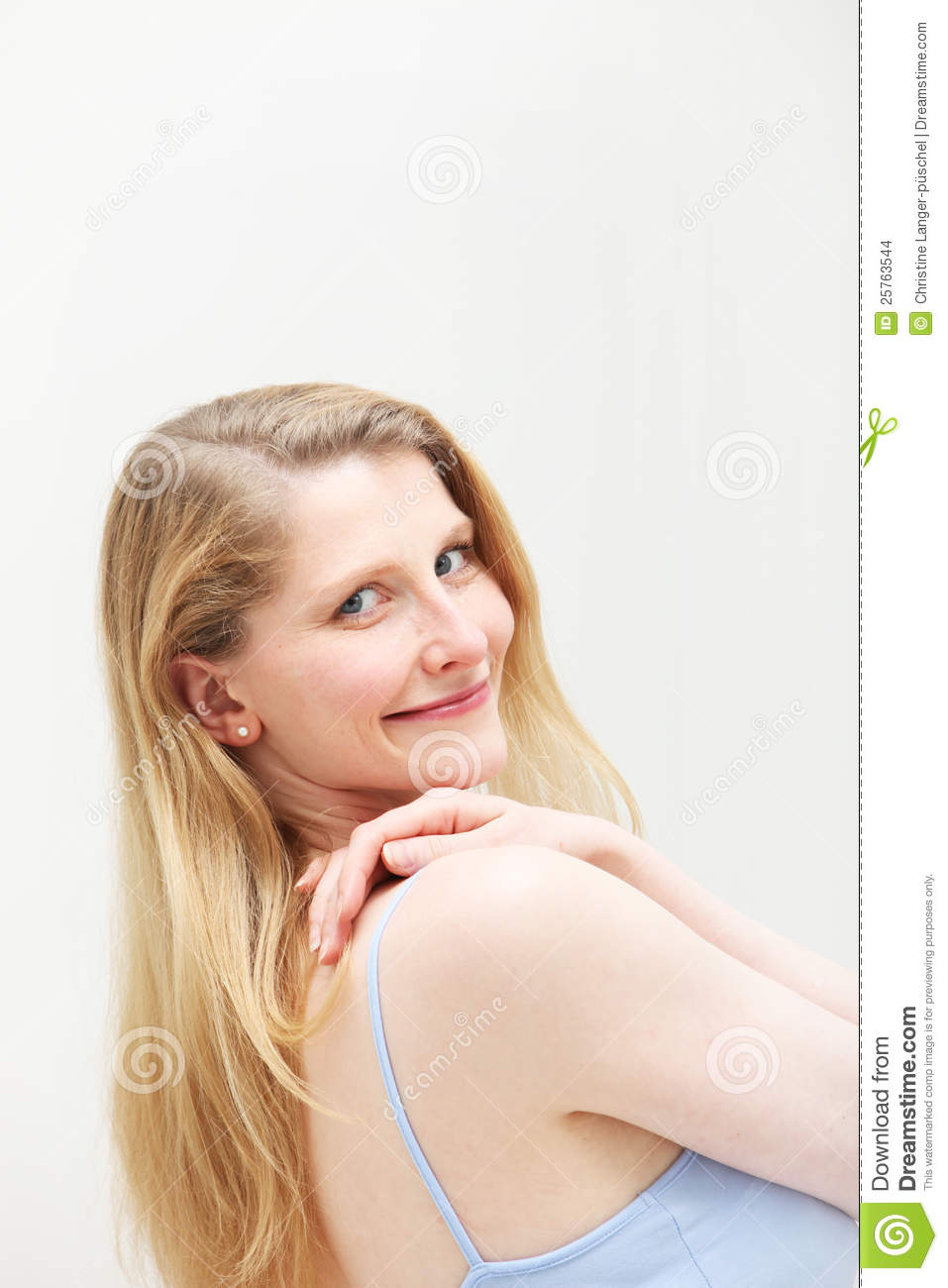 Smiling Blonde Woman Looking Over Her Shoulder Stock
