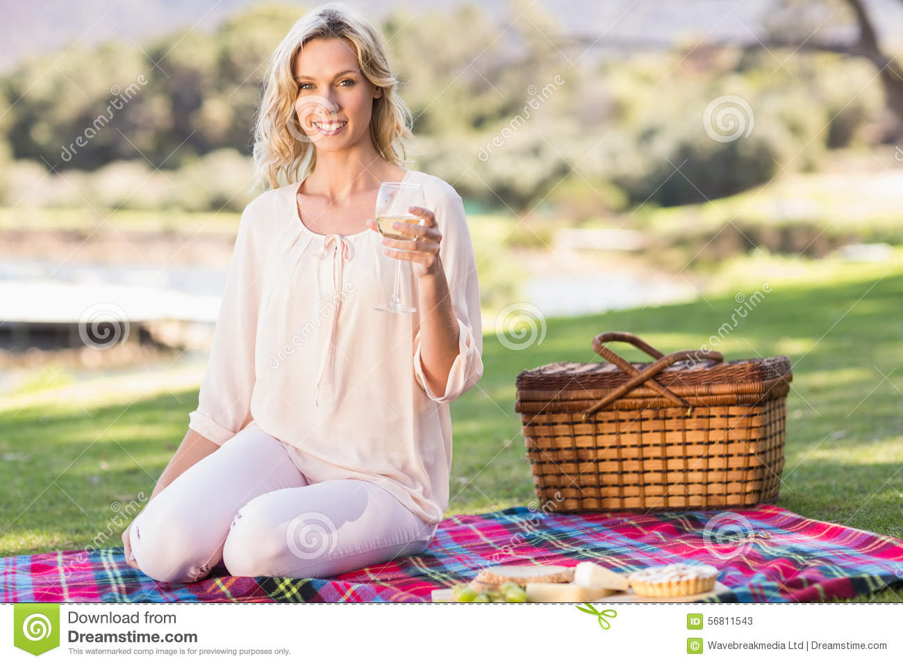 naked woman sitting on a picnic