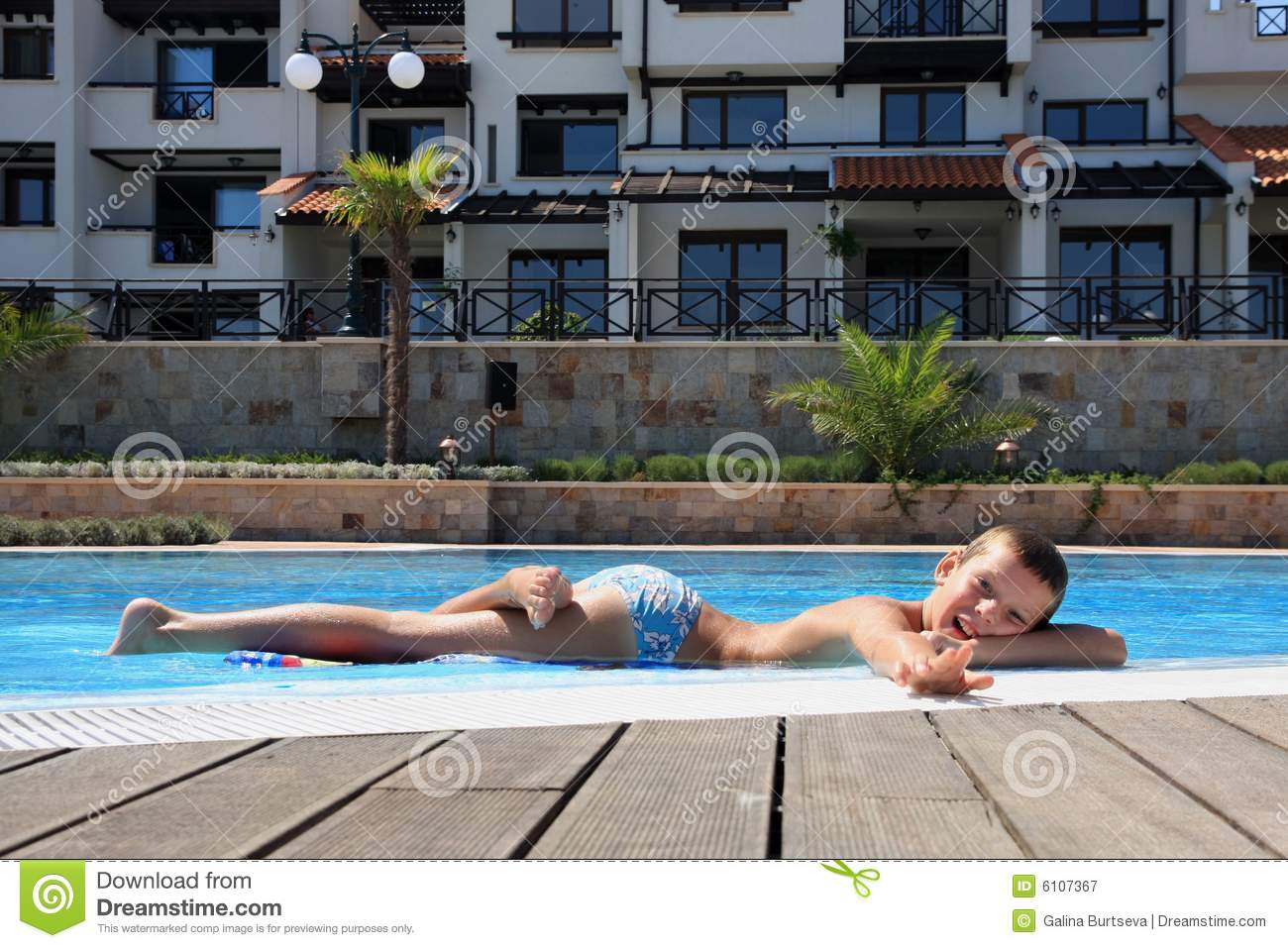 Smiling Boy On The Edge Of Swimming Pool Stock Image Image 6107367