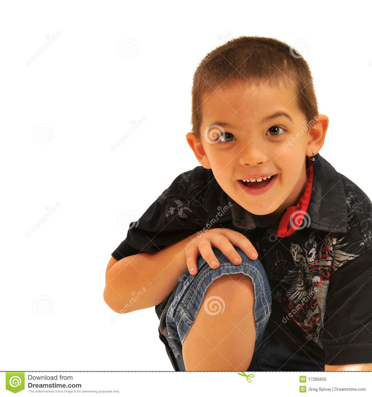 Young Happy Boy With Brown Wet Hair Is Smiling And: Smiling Boy With Hands On Knee Royalty Free Stock Photo