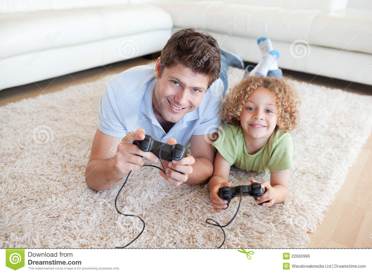 Smiling Boy And His Father Playing Video Games Royalty
