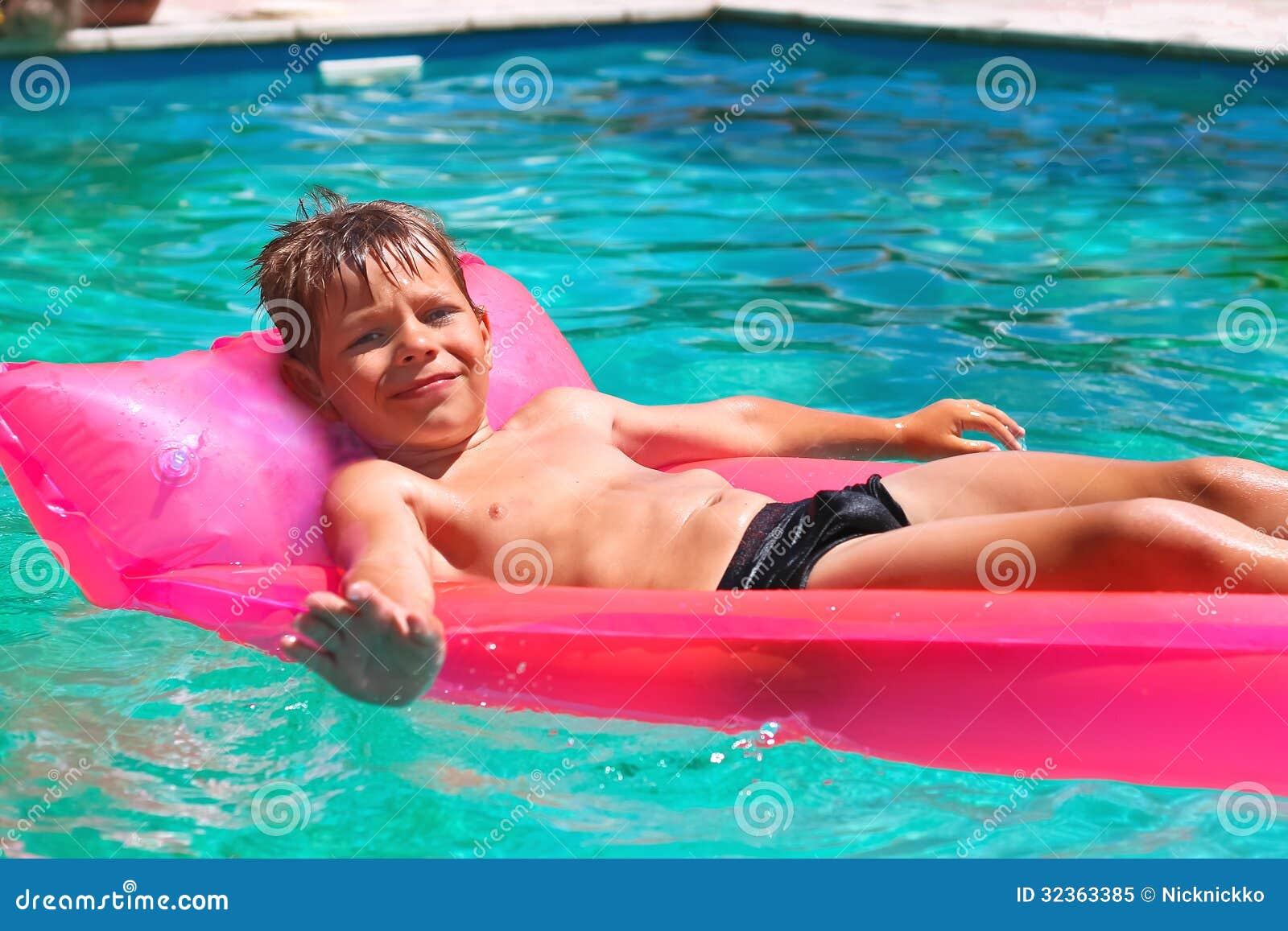 Smiling Boy Lies On Pink Mattress Stock Image Image