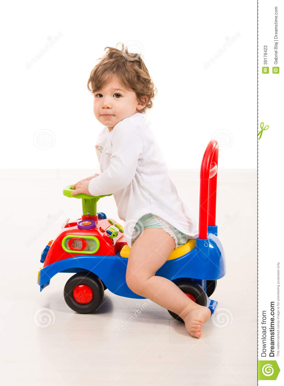 Boys Riding Toys For Toddlers : Smiling boy ride a big car toy stock photo image