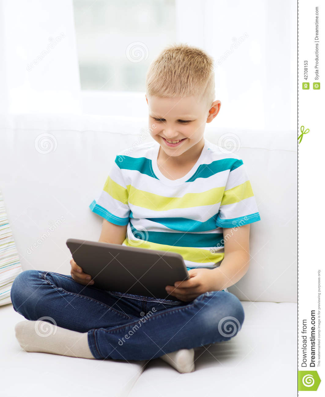 New Home Technology: Smiling Boy With Tablet Computer At Home Stock Image