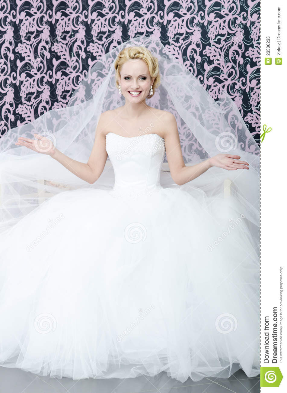 Smiling bride with bunch of flowers to upward looking for Tidy buy wedding dresses