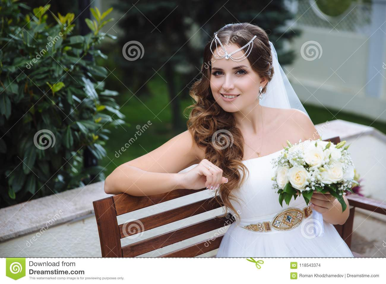 The Smiling Bride Is Dressed In A Greek Style Wedding Dress Her
