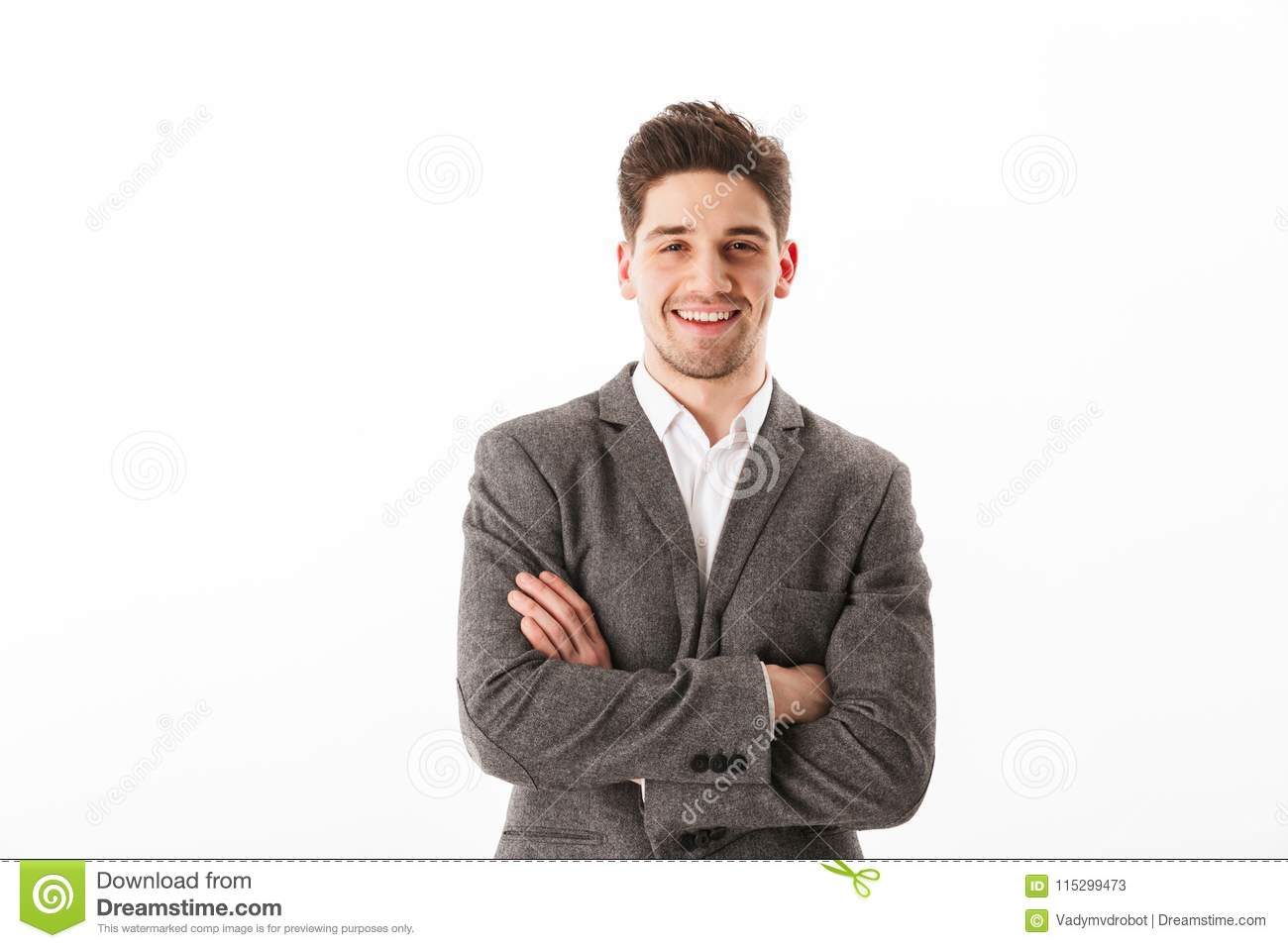 Smiling business man with crossed arms looking at the camera