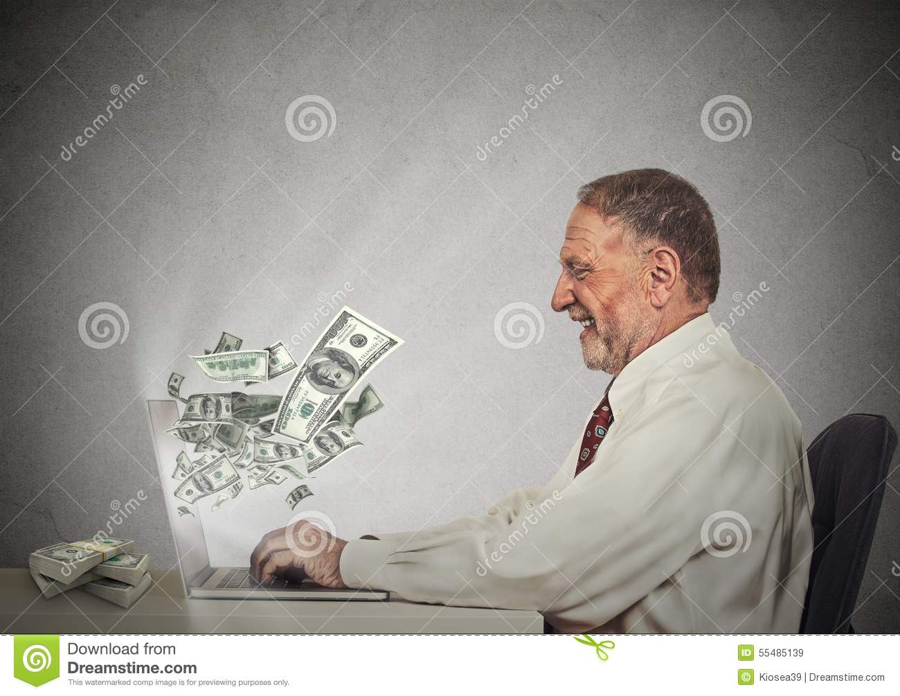 Smiling business man working online on computer earning money