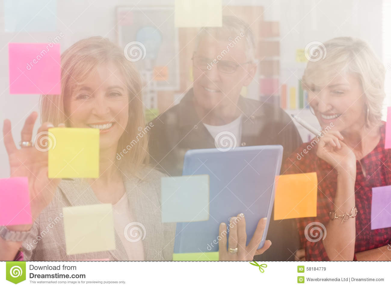 Smiling business team working on tablet