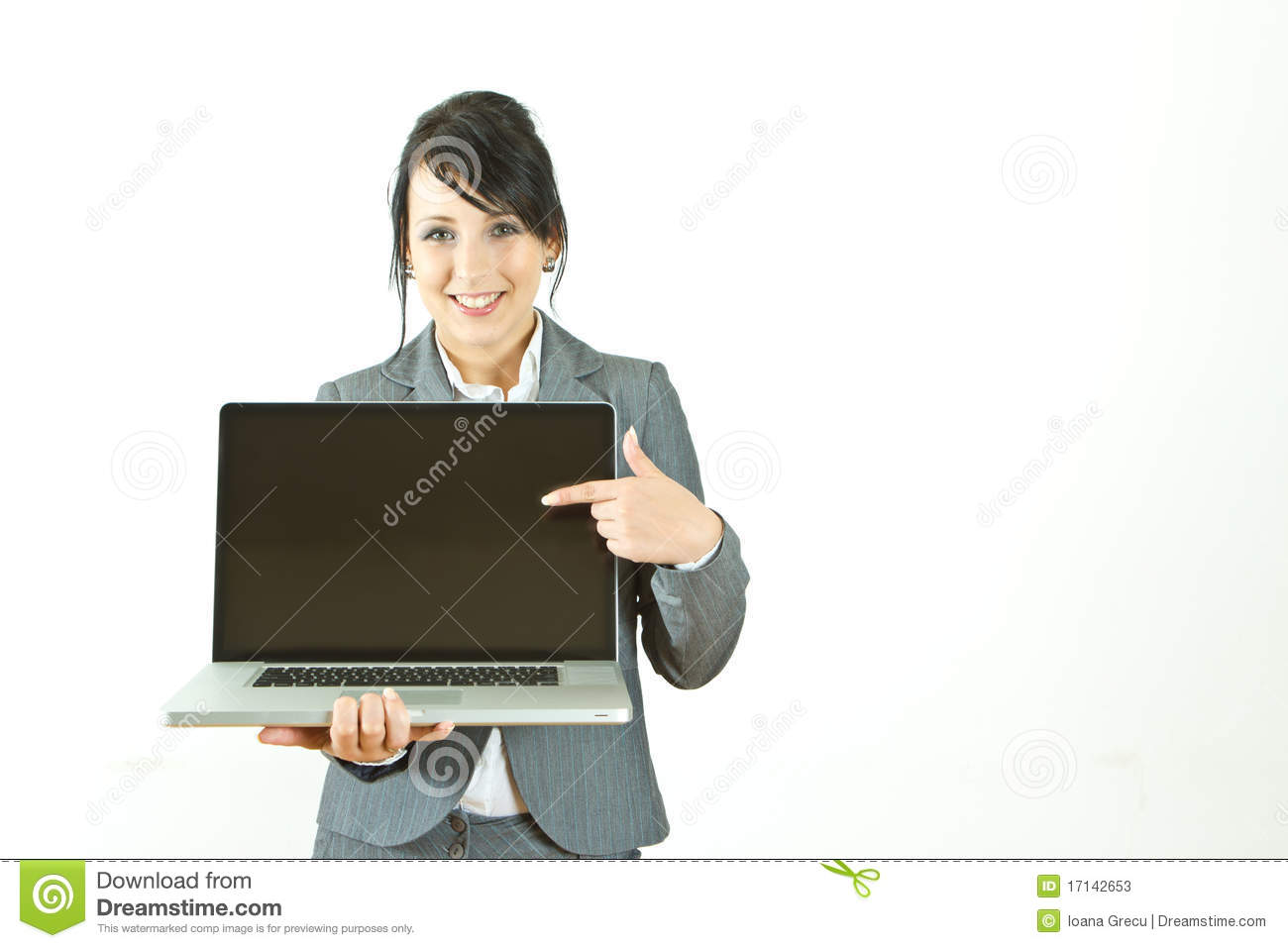 Smiling business woman pointing at laptop
