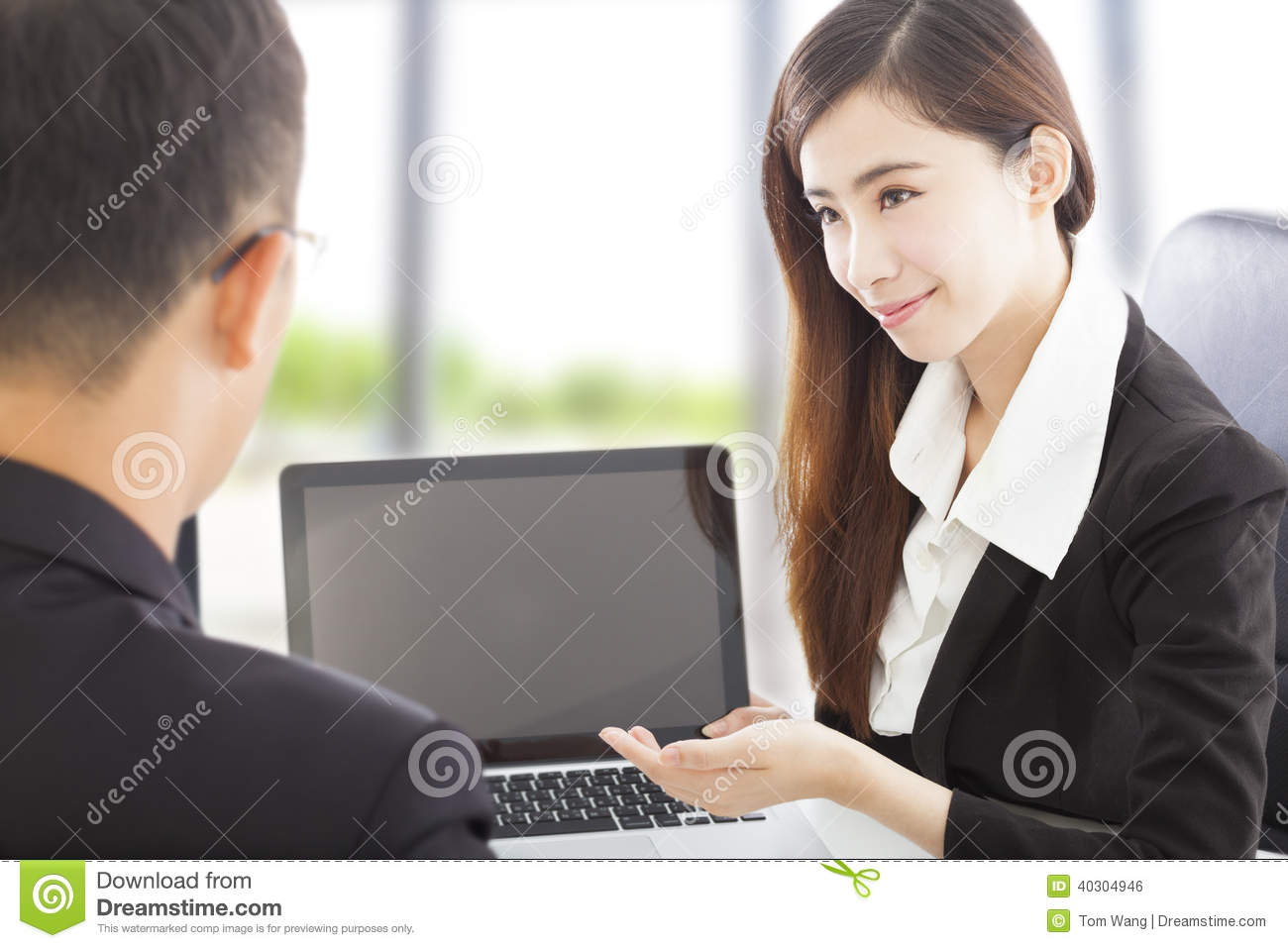 Smiling Business woman presenting and explaining a project