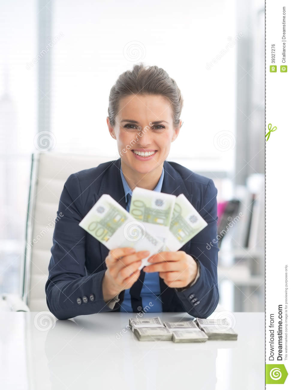 Smiling Business Woman Showing Money Packs Stock Photo ...