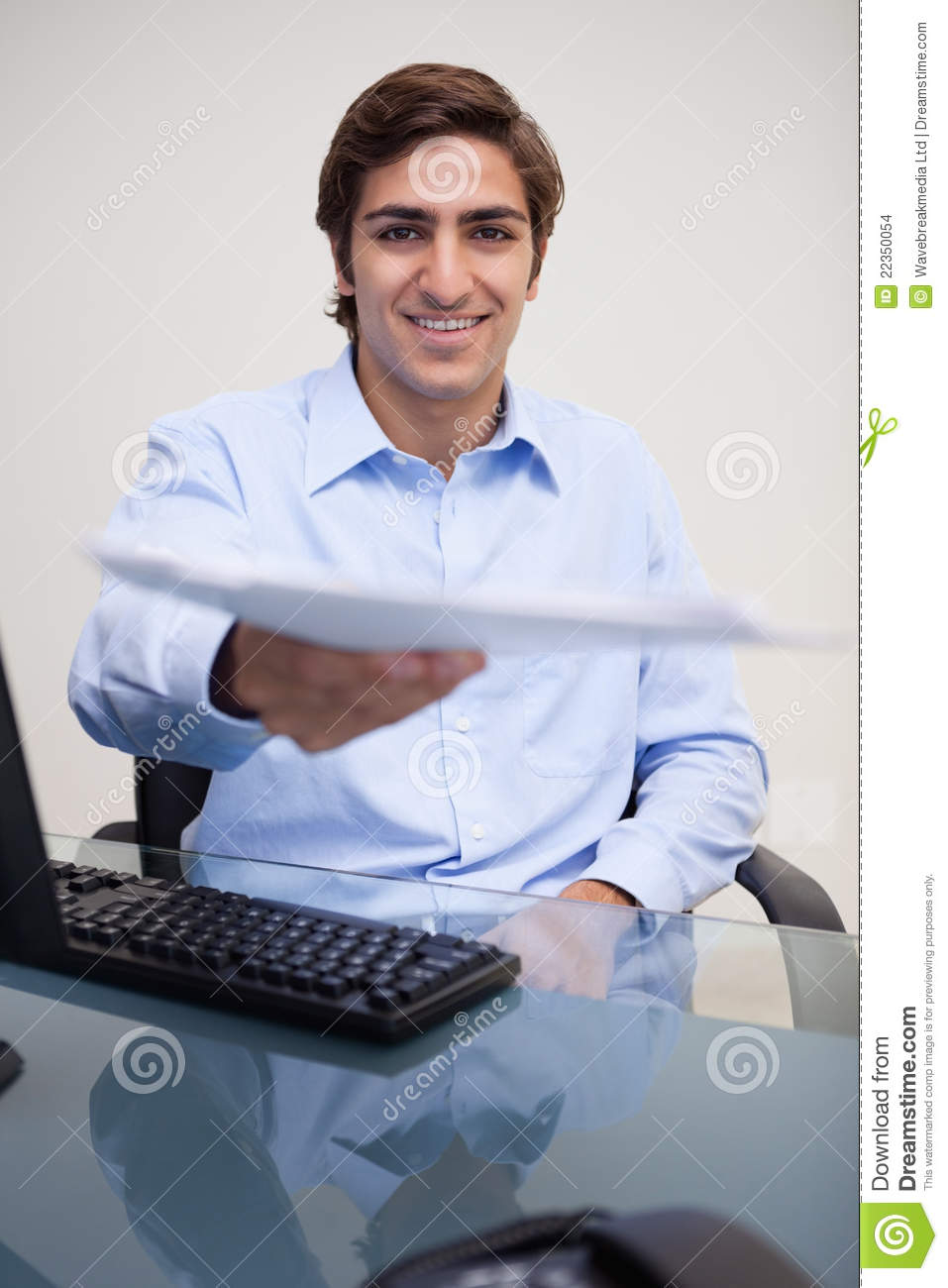 Smiling Businessman Handing Over Paperwork Stock Images