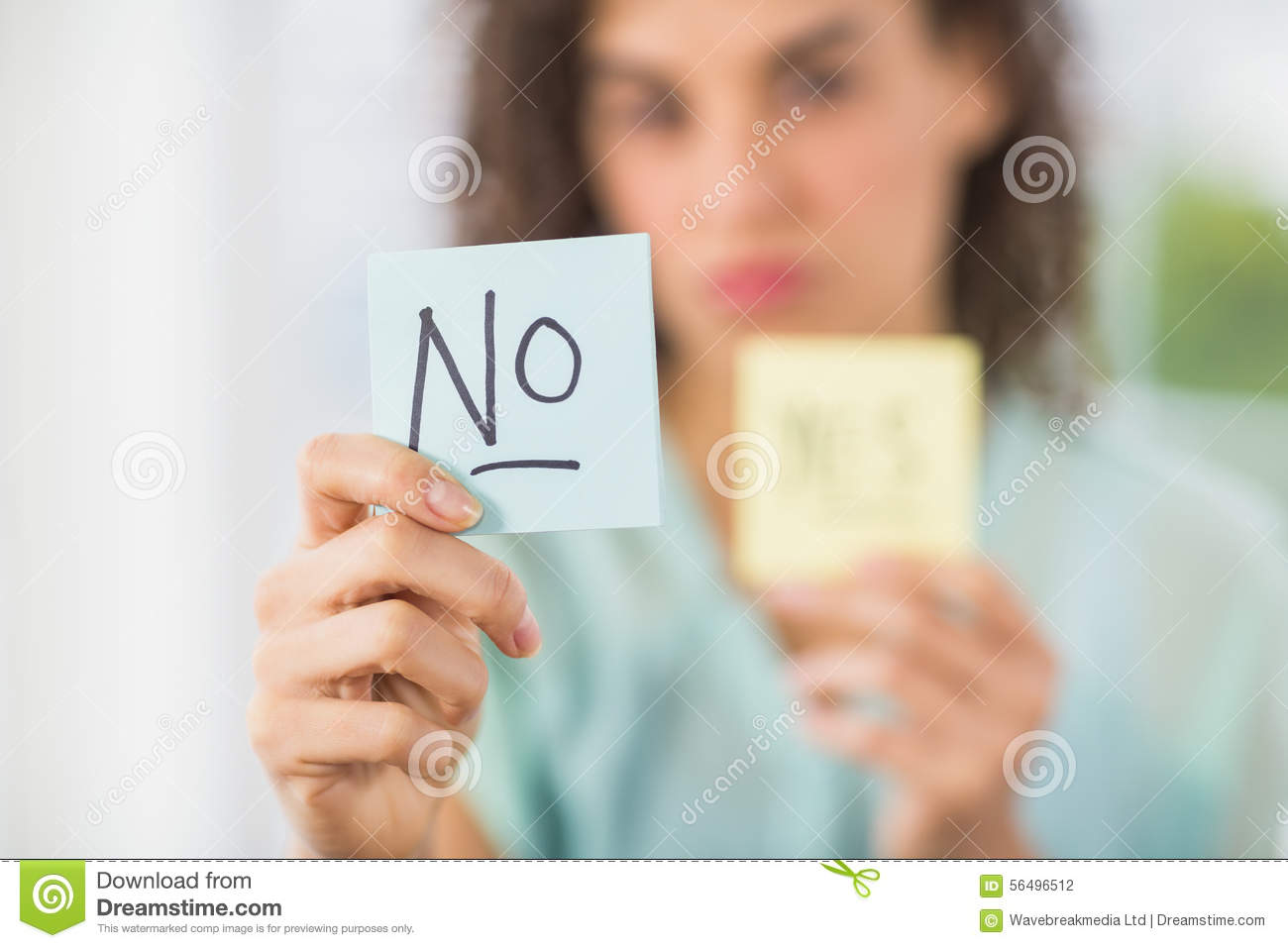 Download Smiling Businesswoman Holding Yes And No Sticks Stock Photo - Image of attractive, businesswoman: 56496512
