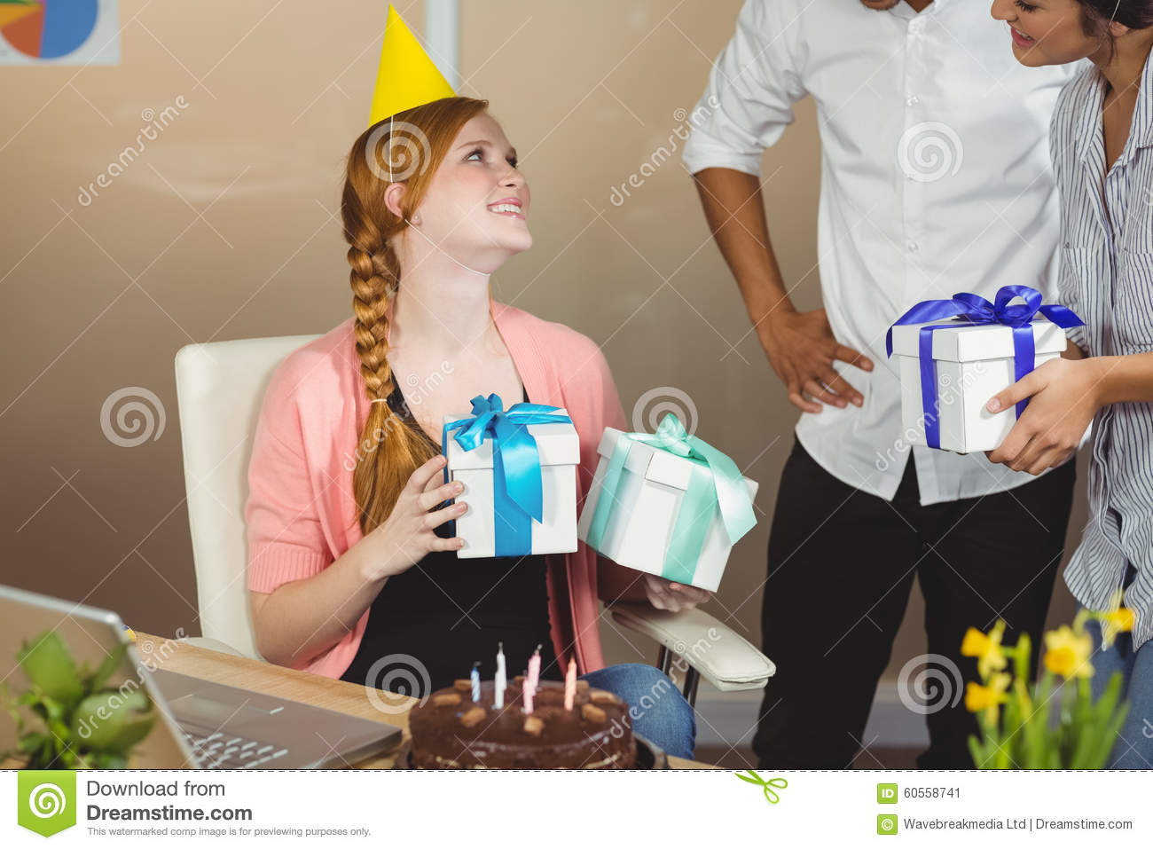 Smiling Businesswoman Receiving Birthday Gifts