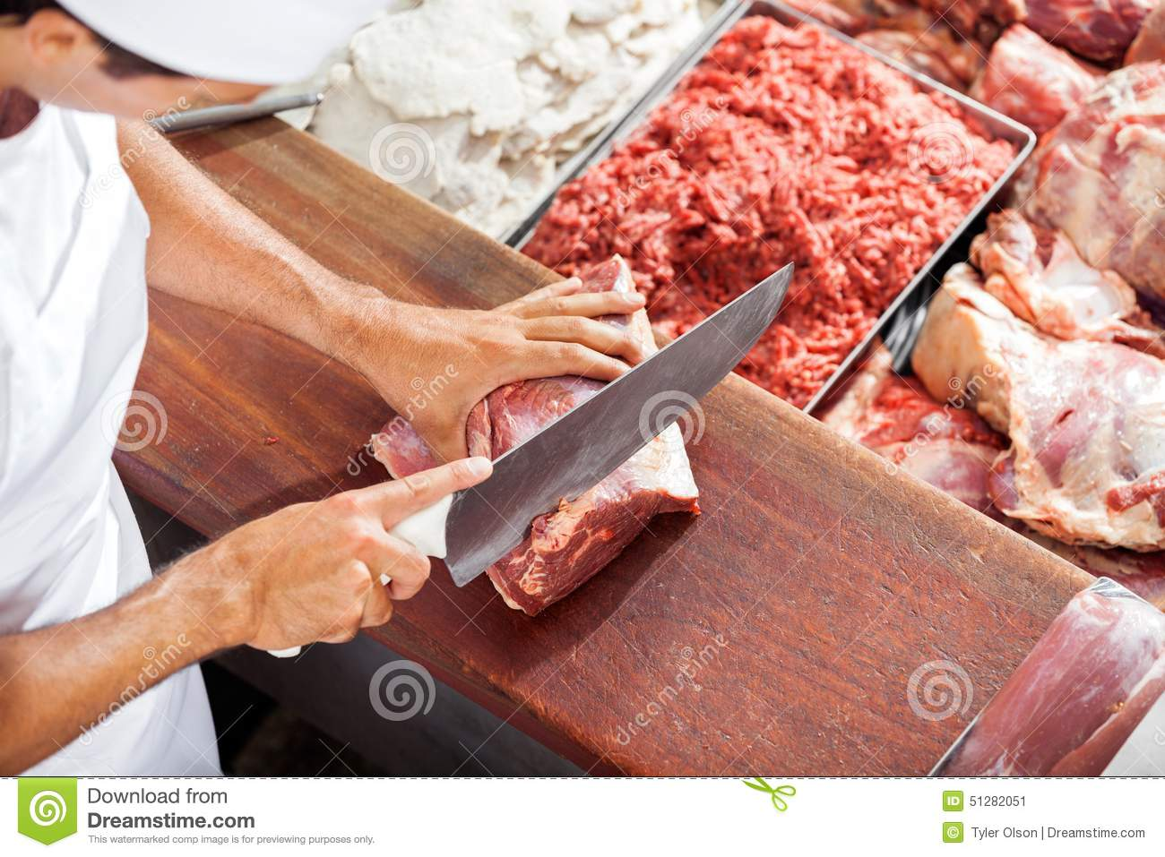 Benny The Butcher Man Of The Kitchen Instrumental : Smiling Butcher Cutting Meat At Counter Stock Photo - Image: 51282051