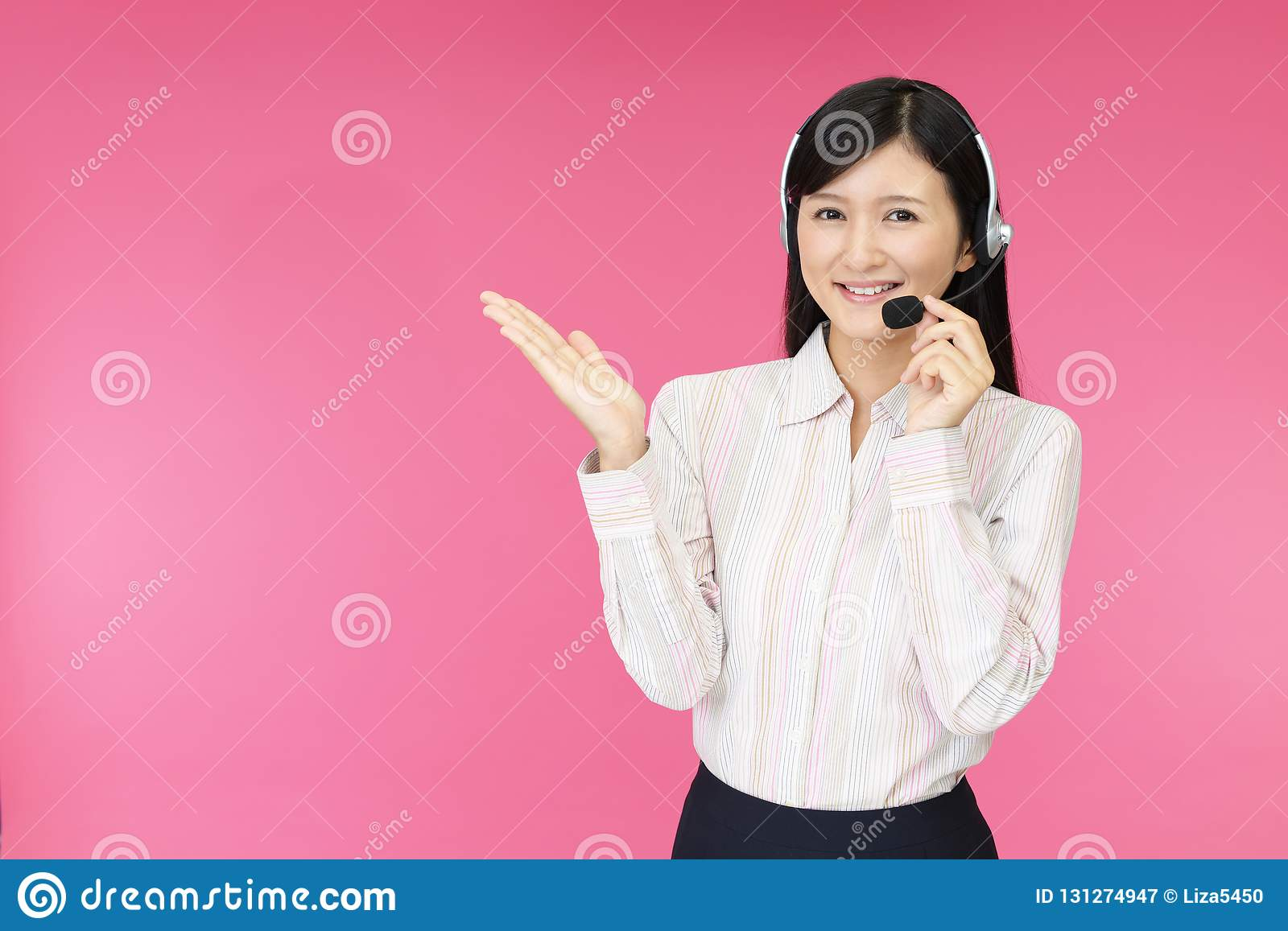 Call center operator showing something on the palm of her hand