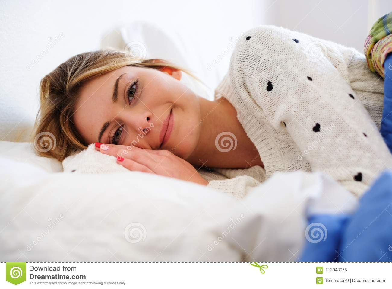 Portrait of young happy woman in the morning