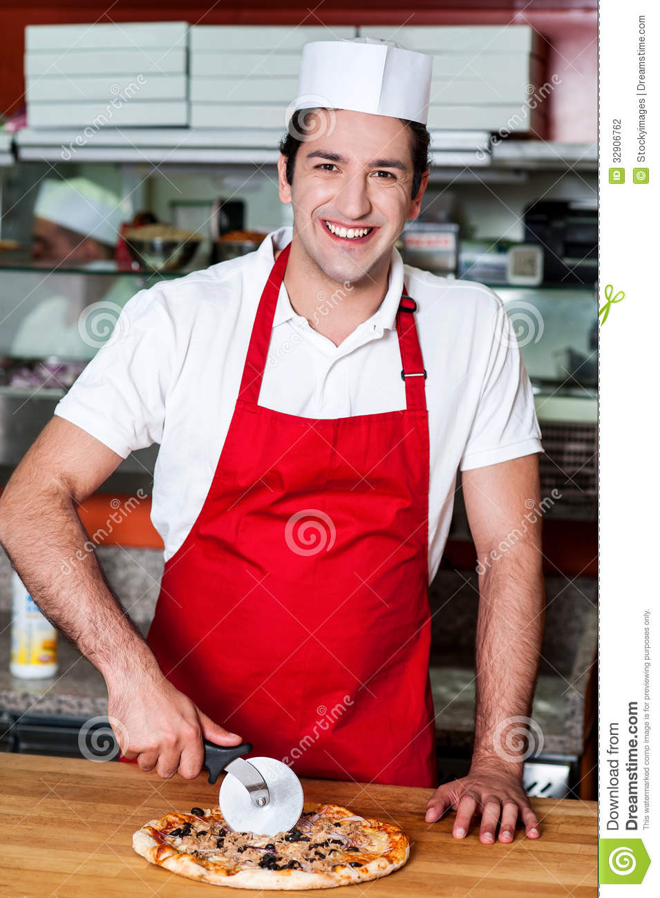 [Image: smiling-chef-cutting-pizza-cutter-young-...906762.jpg]
