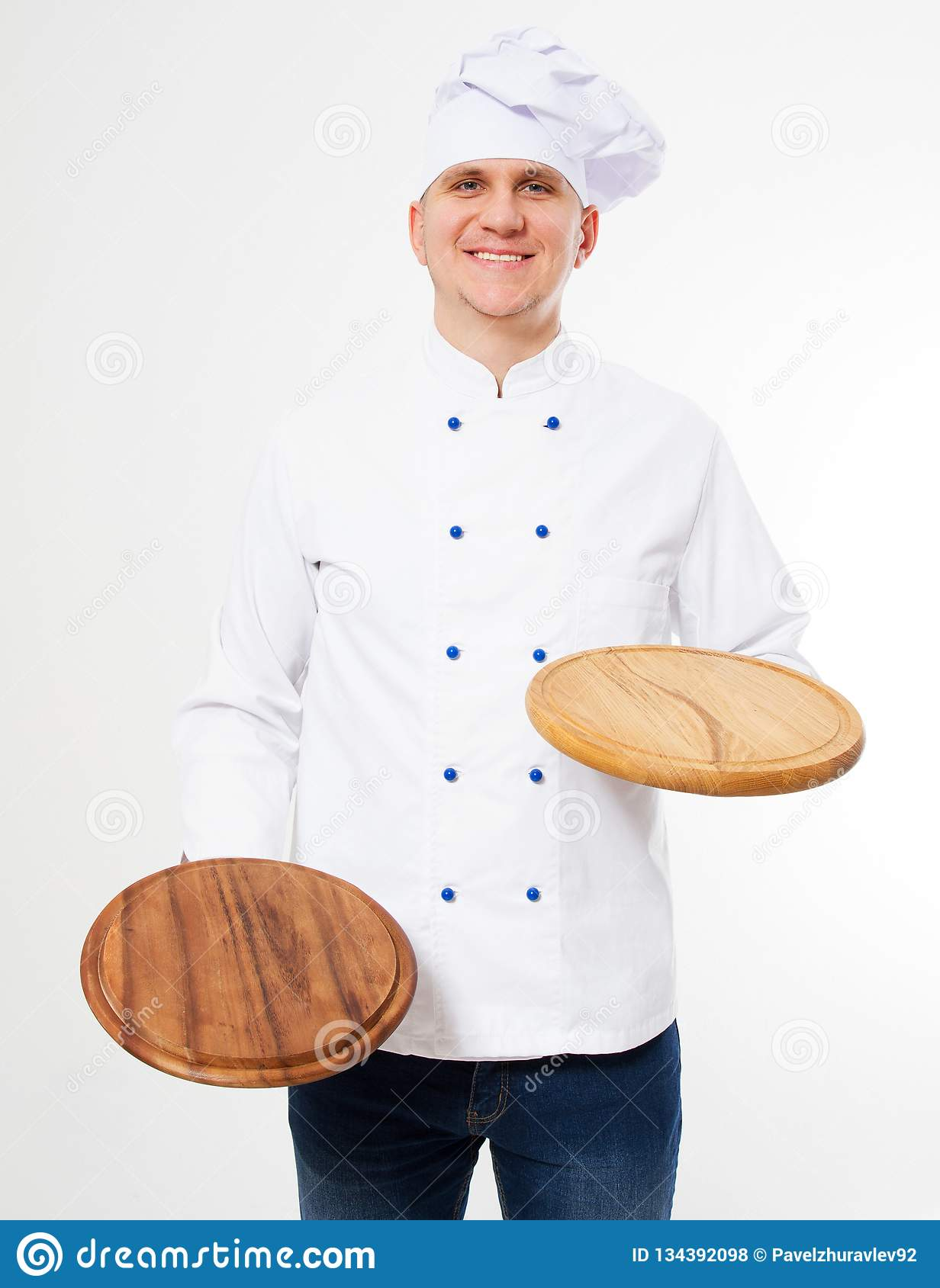 Smiling chef holding empty pizza boards isolated on white background