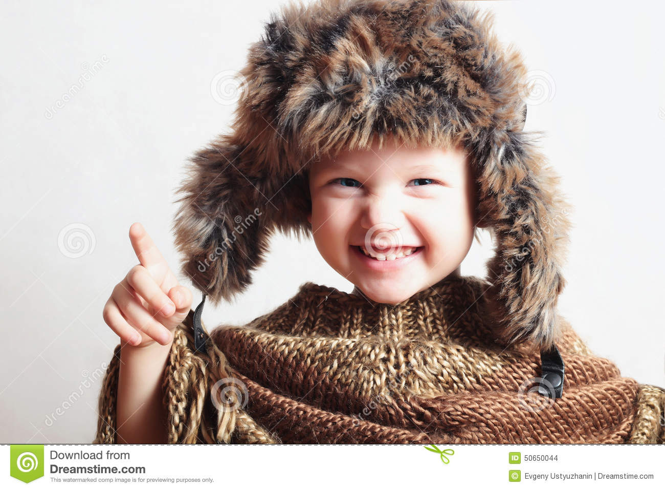 12befa1c4b3 Portrait of smiling child in fur Hat.Kids casual winter style.fashion  little funny boy.children emotion