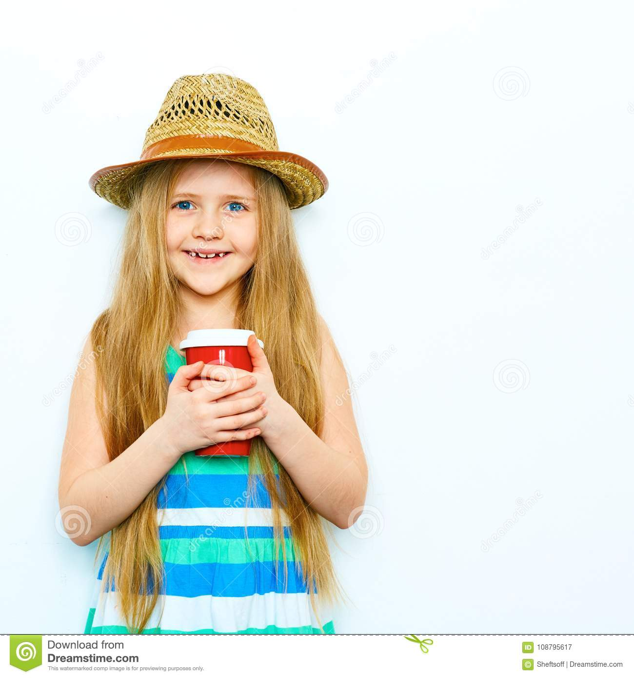 Smiling child girl in hipster style standing against white isol