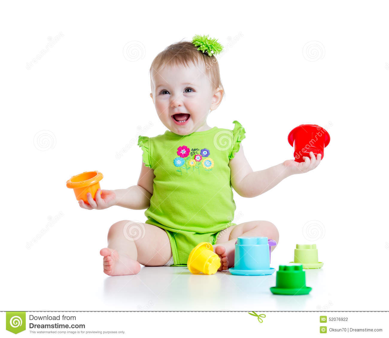 Girl Toys Color : Smiling child girl playing with color toys stock photo
