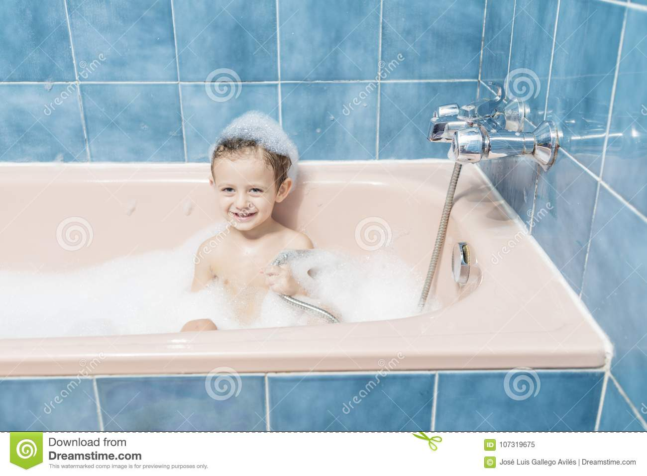 Smiling Child Playing In The Bath Stock Image - Image of blue ...